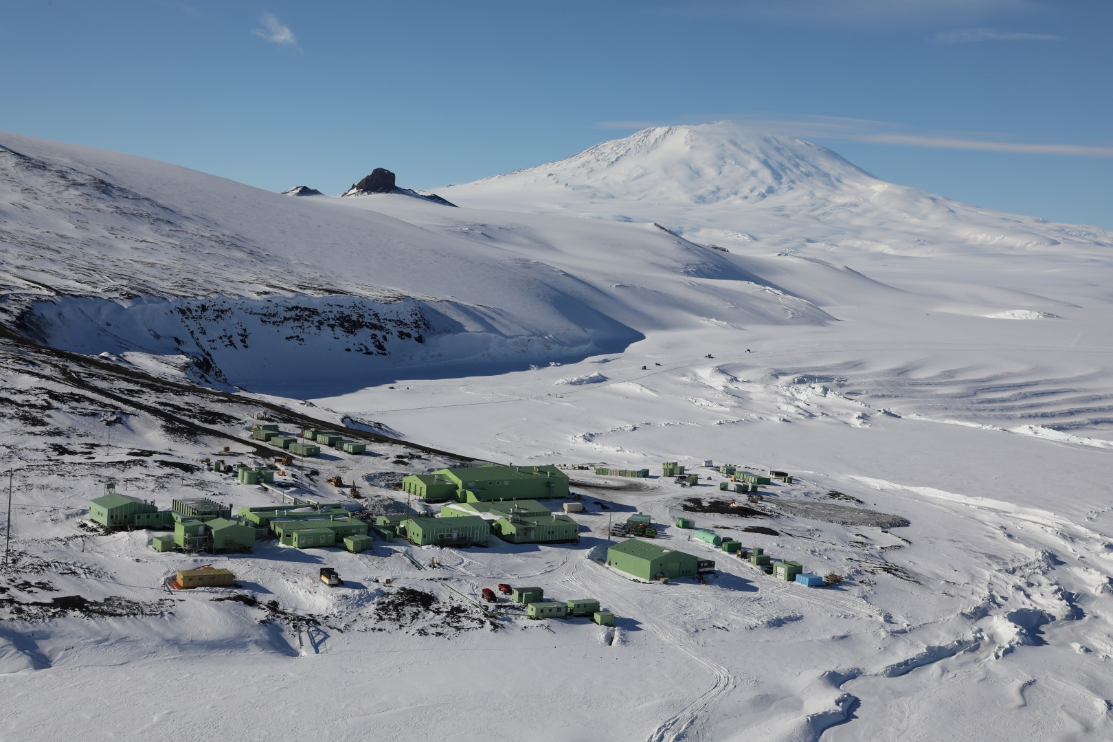 The Scott Base Antarctic research facility located at Pram Point on Ross Island. Mount Erebus is also pictured in the background.