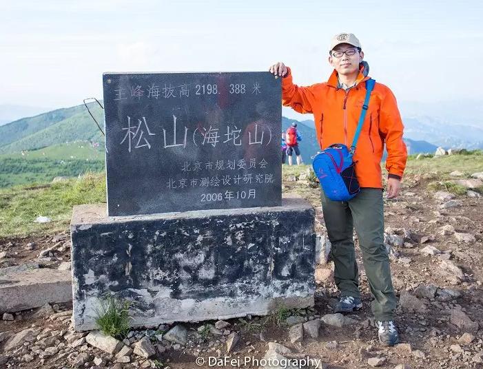 New NeSI team member Dafei Wu standing on mountain summit